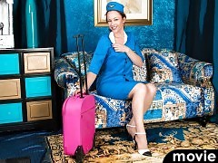A flight attendant uniform highlights hot curves that all natural mom Claire Adams brings to the table.